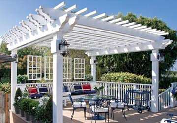 outdoor-dining-area-in-white-pergola-feat-vintage-dining-table-sets